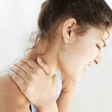 A woman with neck and shoulder pain