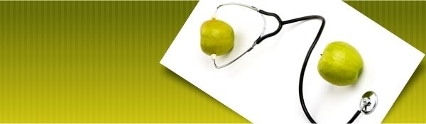 A stethoscope with 2 apples